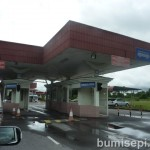 This is Brunei Immigration checkpoint. Stay in the car and produce passport.