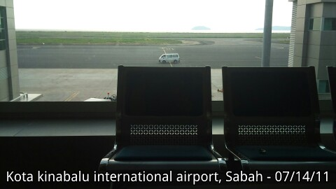 Two empty seats and one Van at BKI airport, Sabah