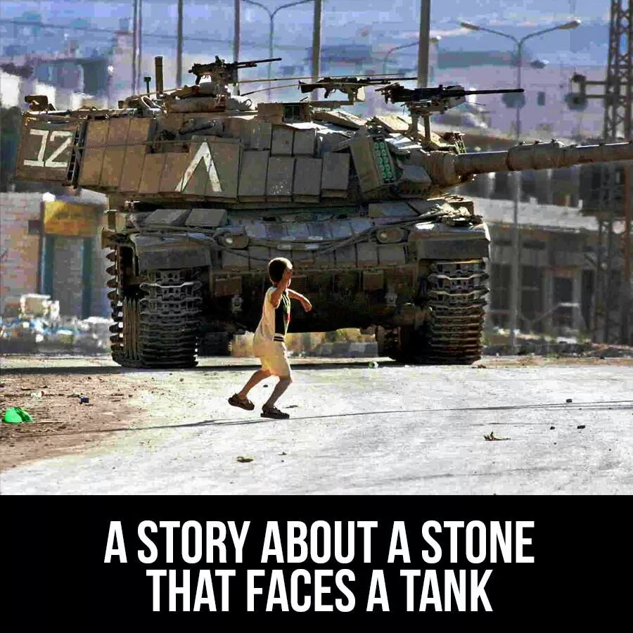 A boy against the tank